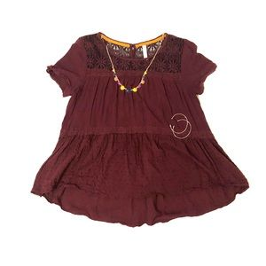 Lacy, maroon top